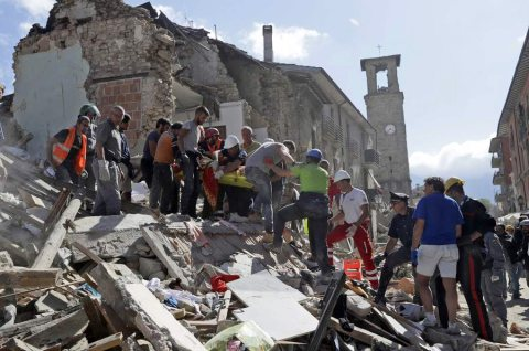 Rescuers carry a stretcher following an earthquake in Amatrice, central Italy, Wednesday, Aug. 24, 2016. A strong earthquake in central Italy reduced three towns to rubble as people slept early Wednesday, with reports that as many as 50 people were killed and hundreds injured as rescue crews raced to dig out survivors. (AP Photo/Alessandra Tarantino) NYTCREDIT: Alessandra Tarantino/Associated Press